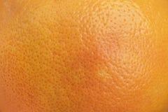 Pomarańczowej łupy powierzchni zbliżenie Cytrus łupy struktury tło Fotografia Stock