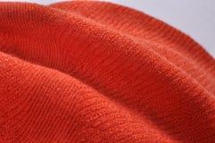 Pomarańczowej czerwieni wełny szalik Obraz Stock