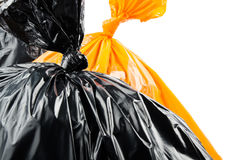 Pomarańczowi i czarni torba na śmiecie Obraz Royalty Free