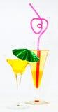 Pomarańczowi tropikalni napoje na bielu Obraz Stock