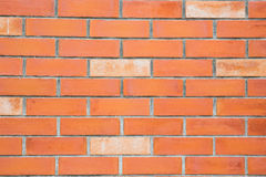 Pomarańczowy Ściana Z Cegieł Zdjęcia Stock