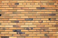 Pomarańczowy ściana z cegieł, tło, kamień Zdjęcia Royalty Free
