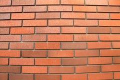 Pomarańczowy ściana z cegieł, tło, kamienna tekstura Fotografia Royalty Free