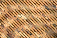 Pomarańczowy ściana z cegieł, tło, tekstura Obrazy Royalty Free