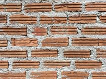 Pomarańczowy cegły i betonowej ściany backgound Fotografia Royalty Free