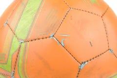 Pomarańczowy futbol dalej odizolowywa białego tło Obrazy Royalty Free