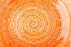 Pomarańczowy glosy tło z spirala wzorem obrazy royalty free