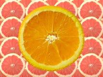 Pomarańczowy grapefruitowy i plasterek obraz stock
