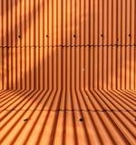 Pomarańczowy metalu prześcieradła dachu tło Obrazy Royalty Free