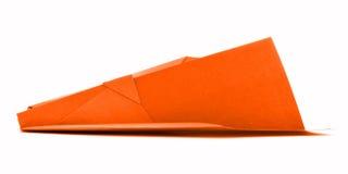 Pomarańczowy origami lotnictwo, papieru samolotu model odizolowywający na białym tle Fotografia Royalty Free