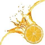 Pomarańczowy plasterek i pluśnięcie sok obrazy royalty free