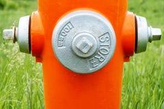 Pomarańczowy pożarniczy hydrant zdjęcia royalty free
