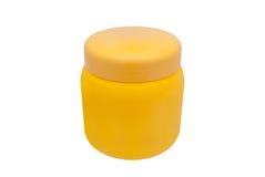 Pomarańczowy Round Kształtny Kosmetyczny zbiornik na Białym Background/Odizolowywającym Zdjęcie Royalty Free
