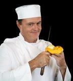 pomarańczowy szef kuchni obieranie zdjęcia stock