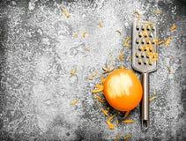 Pomarańczowy zapał z grater Fotografia Stock
