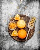 Pomarańczowy zapał z grater Zdjęcia Stock