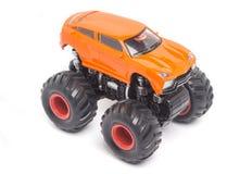 Pomarańcze Zabawkarski samochodowy Bigfoot Fotografia Stock