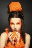 Pomarańczowa dziewczyna. Obrazy Royalty Free