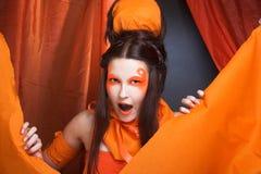 Pomarańczowa dziewczyna. Zdjęcia Stock