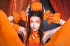Pomarańczowa dziewczyna. Zdjęcie Royalty Free