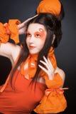 Pomarańczowa dziewczyna. Obraz Stock