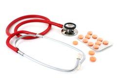 pomarańczowej czerwieni stetoskopu pastylki Obrazy Royalty Free