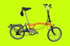 Pomarańczowi bicykli/lów parki na zielonym tle Obrazy Royalty Free