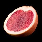 Pomarańczowy grapefruitowy na czarnym tle Zdjęcie Stock
