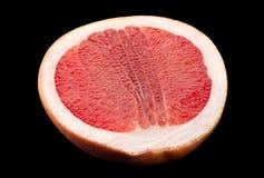 Pomarańczowy grapefruitowy na czarnym tle Obrazy Stock