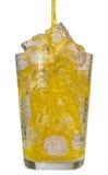 Pomarańczowy napój w szkle z kostkami lodu Obraz Stock