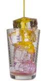 Pomarańczowy napój w szkle z kostkami lodu Obrazy Royalty Free