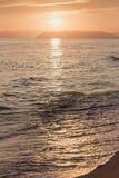Pomarańczowy zmierzch i morze obraz stock
