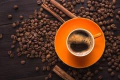 Pomarańczowa filiżanka kawy Obrazy Stock