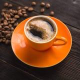 Pomarańczowa filiżanka kawy Obraz Royalty Free