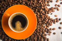 Pomarańczowa filiżanka kawy Fotografia Stock