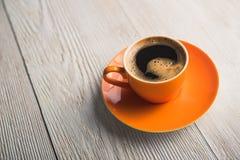Pomarańczowa filiżanka kawy Zdjęcie Royalty Free