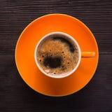 Pomarańczowa filiżanka kawy Obrazy Royalty Free
