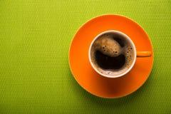 Pomarańczowa filiżanka kawy Fotografia Royalty Free
