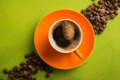 Pomarańczowa filiżanka kawy Obraz Stock