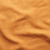 Pomarańczowy sukienny materiał Zdjęcie Royalty Free