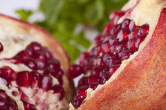 Pomegranat with leafs Royalty Free Stock Photo