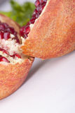 Two pieces of pomegranat Royalty Free Stock Photography