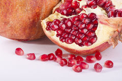 Torn pomegranat. Pomegranat torned by peaces and shots on whita background stock images