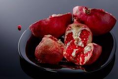 pomegranate предпосылки черный Стоковая Фотография