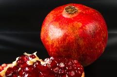 pomegranate предпосылки черный Стоковое Изображение RF