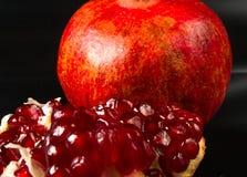 pomegranate предпосылки черный Стоковая Фотография RF