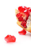 Pomegranate. Piece some one is out of them Royalty Free Stock Photo