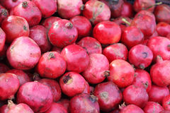 Pomegranate. Lots of red pomegranates at a market Royalty Free Stock Image
