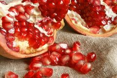Pomegranate. Open pomegranate with seeds on a cloth background Royalty Free Stock Photo