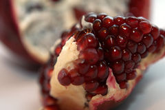 Pomegranate. Macro of a Pomegranate on White Stock Photos